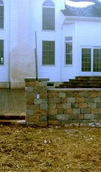 900 square foot EP HENRY patio with seating walls, pillars and step