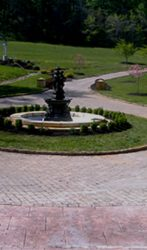 ,000 square foot EP HENRY driveway in Coventry II with a Coventry curb stone border and circle