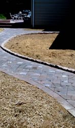 Paver walkway with cobble stone boarder
