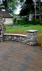 Paver patio, seat walls, fireplace, grill