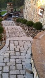 Paver steps corn to patio at stone house