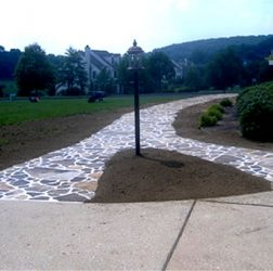 Natural stone walkway in cement