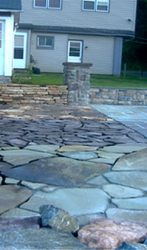Mason displays constructed by Landesign Hardscapes and Masonry that can be seen at Woodward Landscape and Supply.