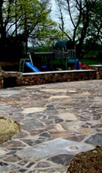 Hand Chiseled Stone Patio, Outdoor fireplace, Seating walls and steps