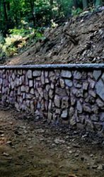 Mason stone wall with sandstone on top