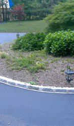 Cobblestone in cement edging around a driveway