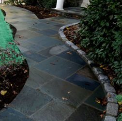 Flagstone in cement walkway with cobblestone boarder
