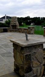 Flagstone patio, columns, walls, fire place