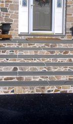 Stone mason steps with a flag stone tread