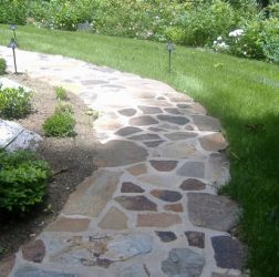 Natural stone in cement walkway