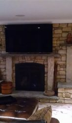 Indoor stone fireplace, limestone mantles with sandstone supports