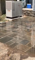 Flagstone Patio with a stone staircase and stone seating wall