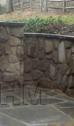 Retaining wall with a Seat Wall and Irregular Stone Patio