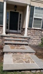 Steps and landings with irregular shape stone, bordered with rectangular stone.