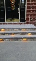 Limestone steps with slider lights installed