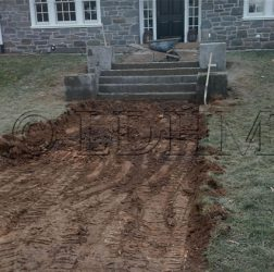 During - Flagstone walk in concrete with steps and columns bordered on Belgian Block. Haverford, PA.