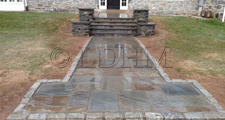 Shinier Finish - Flagstone walk in concrete with steps and columns bordered on Belgian Block. Haverford, PA.
