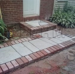 Flagstone walk bordered with red brick